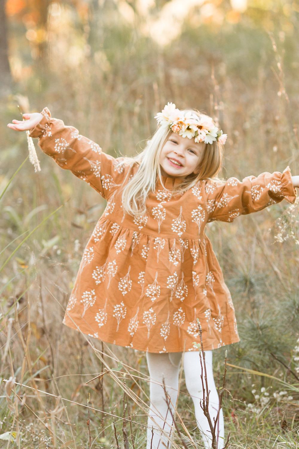 Little girl dances in a grassy field, London Adelaide family photography, Asheville family photographers, tips for planning family photos, lifestyle blog