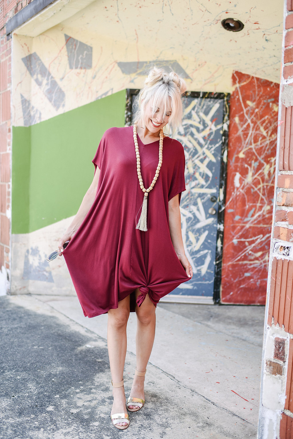 Brooke from The Tony Townie fashion/lifestyle blog wears Yana K burgundy tunic dress with wooden bead necklace and Loeffler Randall metallic sandals in downtown Asheville
