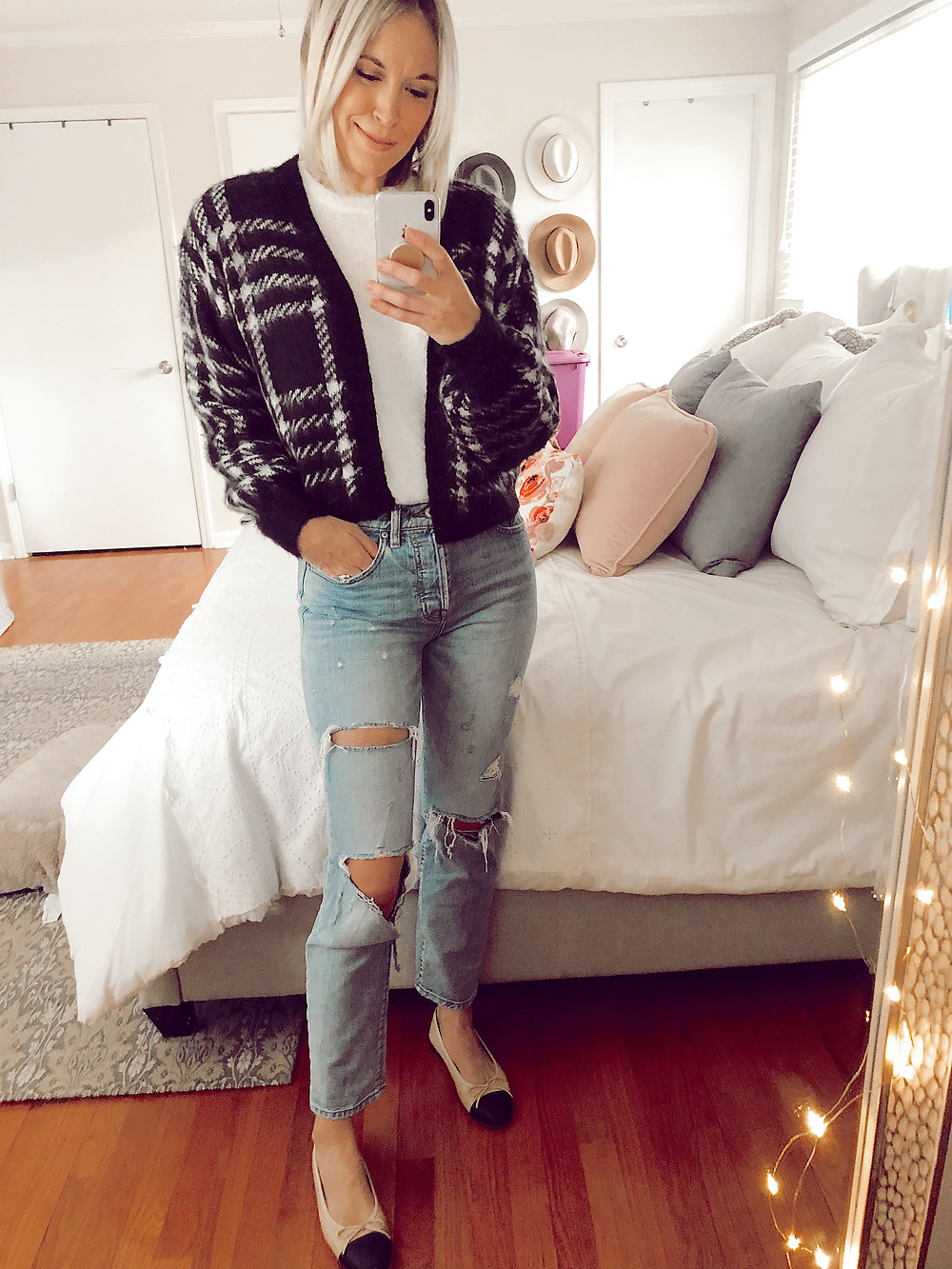 Outfit selfie in H&M fuzzy white pullover sweater, black plaid cardigan, ripped jeans, and ballet flats, fashion blog, casual fall outfit ideas