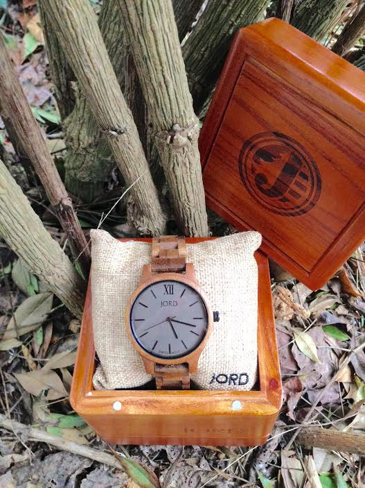 JORD Wood Watch in Koa and Ash sits in its embossed wooden box in a wintry garden.
