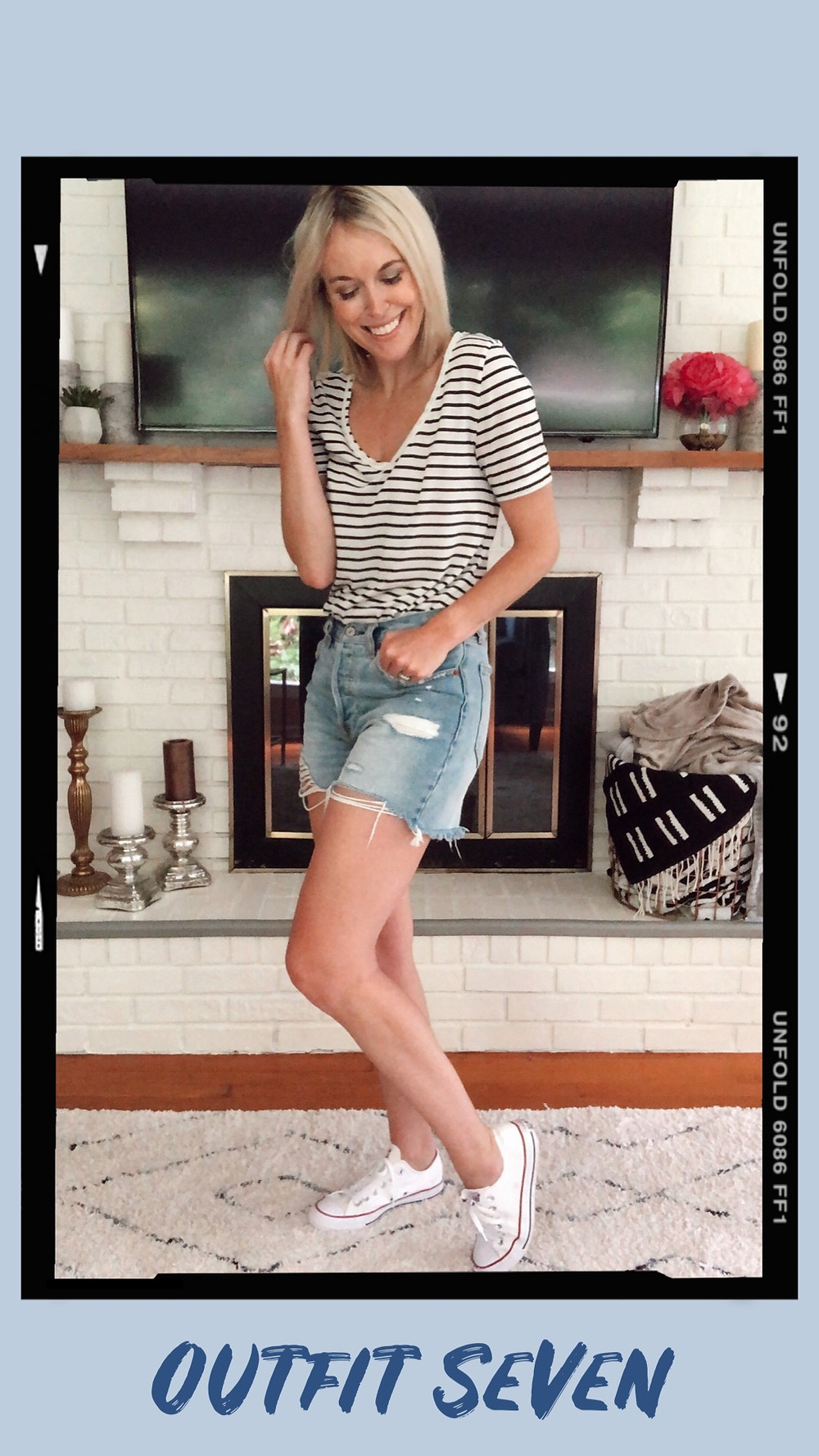 Summer capsule wardrobe outfit idea, striped t-shirt, Abercrombie ripped high-waisted denim shorts, white Converse sneakers, wardrobe stylist and fashion blogger