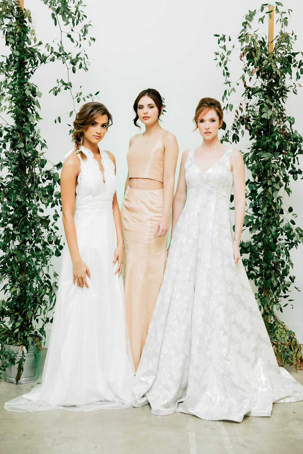Three models wearing Asheville Couture custom wedding gows