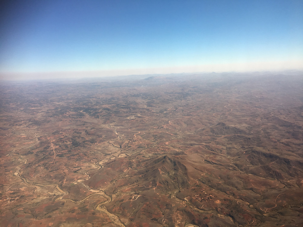 Photo of Madagascar taken from plane by Chelsea Feast. You can see the vast deforestation