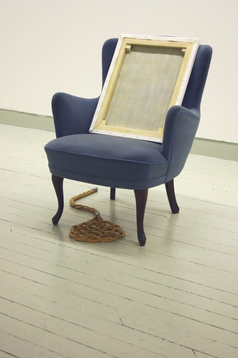 Chair with painting and carpet beater