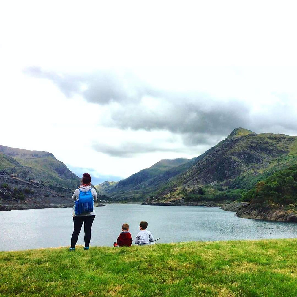 explaining veganism to children in the great outdoors on Mount Snowdon, Snowdonia, Wales. Walking with nature in a natural landscape.