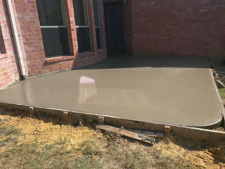 Ready-mixed concrete poured after placing steel reinforcement to make a patio, Roman Groundworks, East Sussex