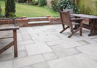 New flagstone patio and backyard, outdoor garden patio with furniture, Roman Groundworks, East Sussex