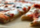 2c-traiteur-plaque-pizzas.jpg