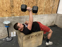 Zac doing dumbbell exercises at the best crossfit gym in altus, oklahoma