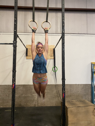 Alicia doing ring muscle ups at the best gym in altus oklahoma