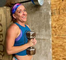 Alicia doing a dumbbell workout at the crossfit gym, the spot in altus , ok