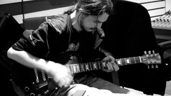 Thomas Chaillan and guitar.jpg