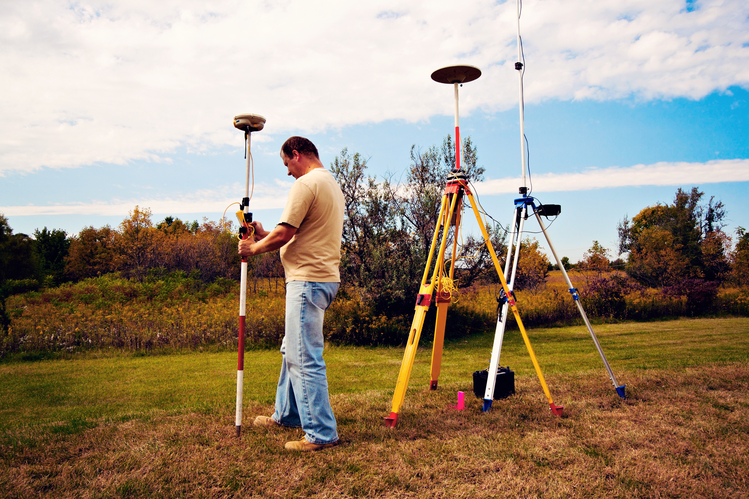 GPS survey - land surveyor in the field.
