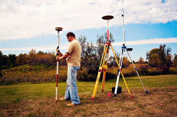 GPS survey - land surveyor in the field.