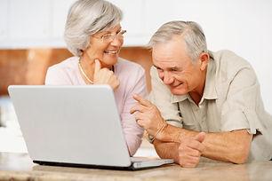 2 adults on laptop.jpg