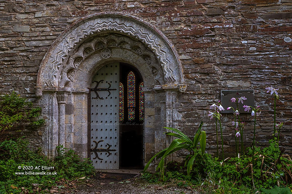 The ornate doorway and windows beyond of St Anthony in Roseland Church photo and fine art print