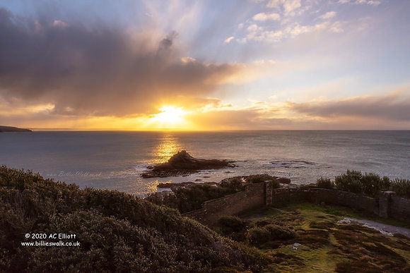 A moody sunrise sky over the sea and rocks at Prussia Cove photo and fine art print