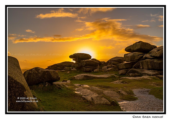 Sunset behind the rocks on Carn Brea Greeting Card