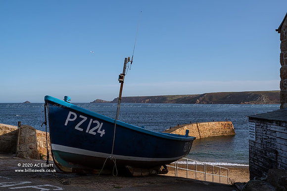 Small boat above harbour at Sennen Cove photo and fine art print
