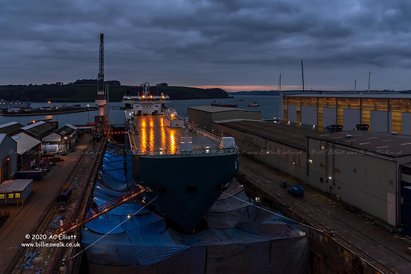 Lights streaming across the deck of a ship in dry dock photo and fine art print