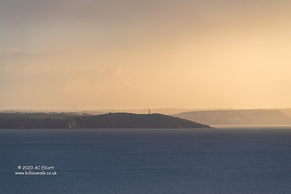 Hazy distant view of Gribbin Head and Daymarker photo and fine art print