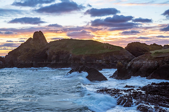 A beautiful sunset behind Asparagus Island at Kynance Cove photo and fine art print