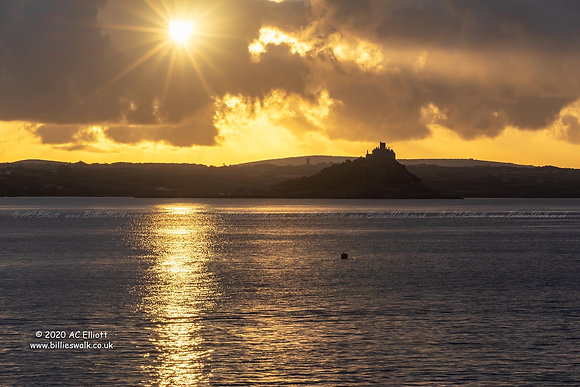 St Michael's Mount silhouetted against beautiful sunrise photo and fine art print