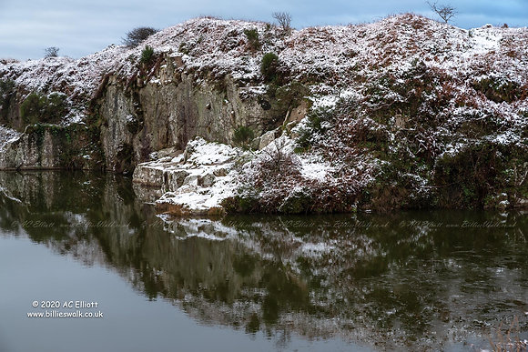 Snow on the sides of the flooded Carn Marth Quarry photo and fine art print