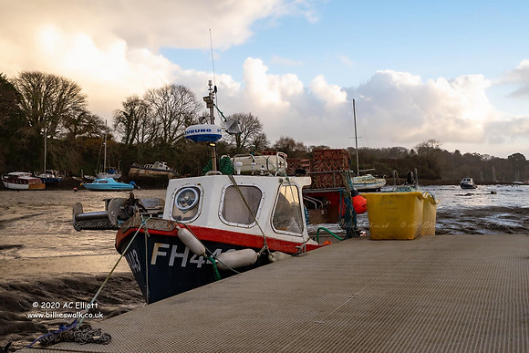 Small fishing boat moored in Penryn photo and fine art print