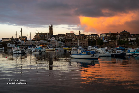A split screen sunrise sky at Penzance Harbour photo and fine art print