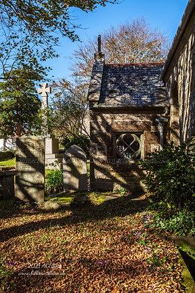 Dappled light on Ludgvan Parish Church's porch and memorial photo and fine art print