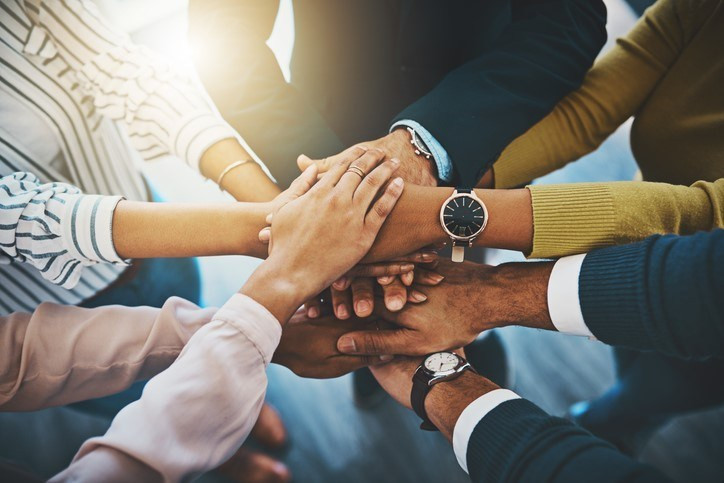 teamwork-hands-credit-PeopleImages.jpg
