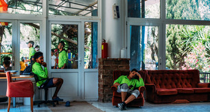 Meetings with officials and other NGO representatives became a fixture as the municipality moved to close down the camp. Here volunteers rest at the entrance to the administration building as they ensure talks are uninterrupted.