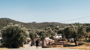 On the edge of the Olive grove, an overflow area of Moria Camp.