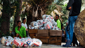 This was one of the first food distributions, which happened twice a day. As time went on it became more and more difficult to raise funds to cover nutrition and sanitation.