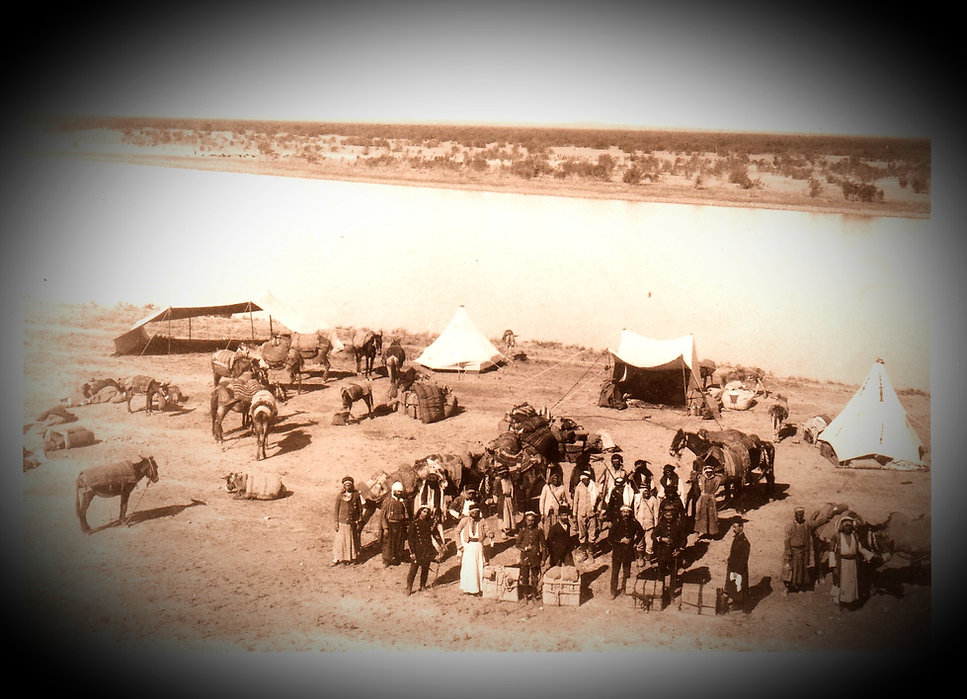 A convoy on the banks of the Euphrates River