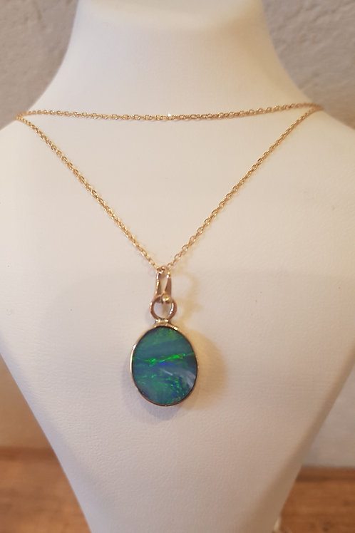14 carat gold necklace with blue opal stone