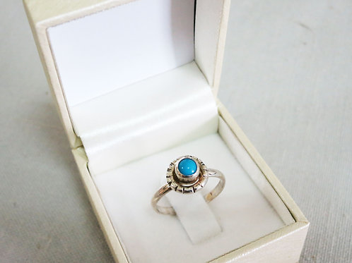 Silver ring and blue stone