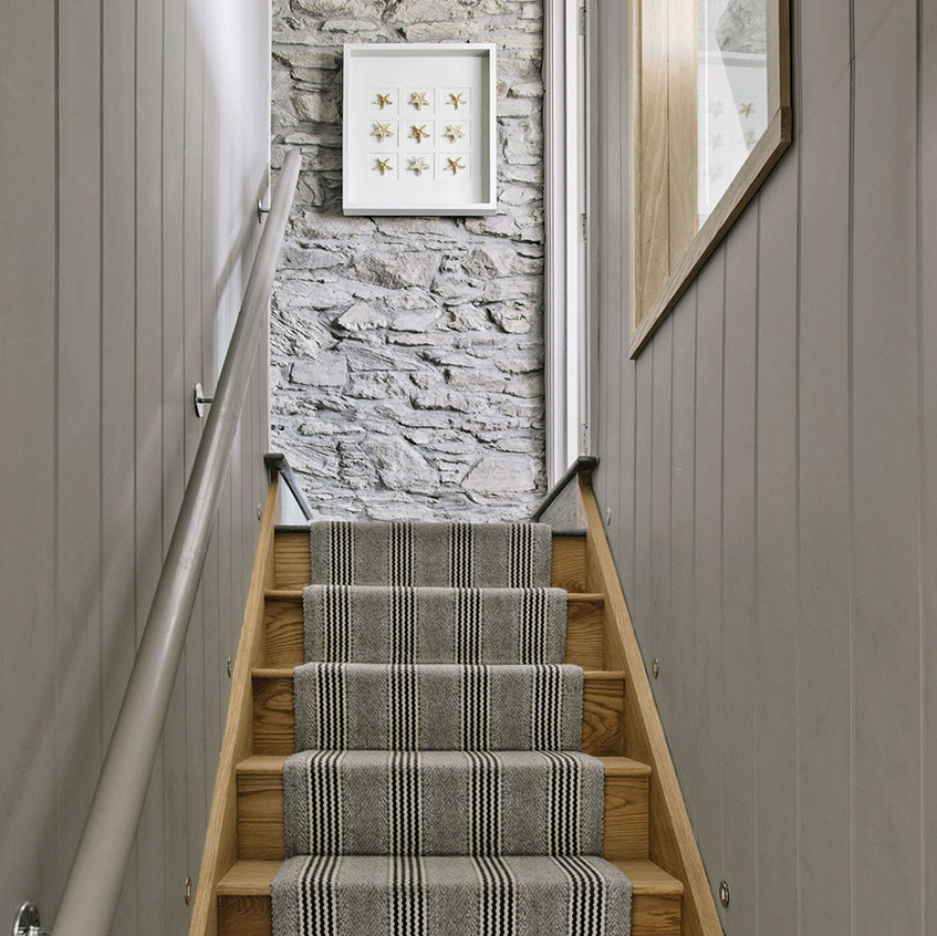 Grey-staircase-with-exposed-brick-wall-a