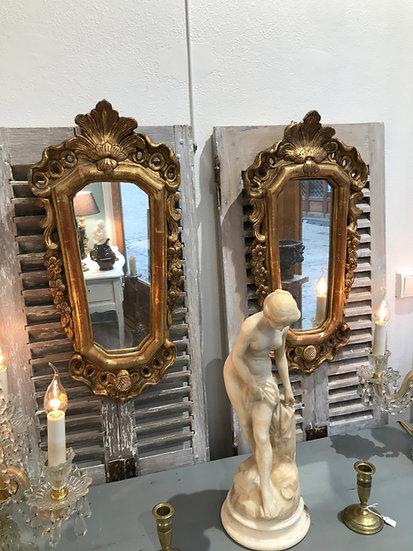 Paire de miroirs anciens en bois doré d'époque XVIII ème de style louis XV
