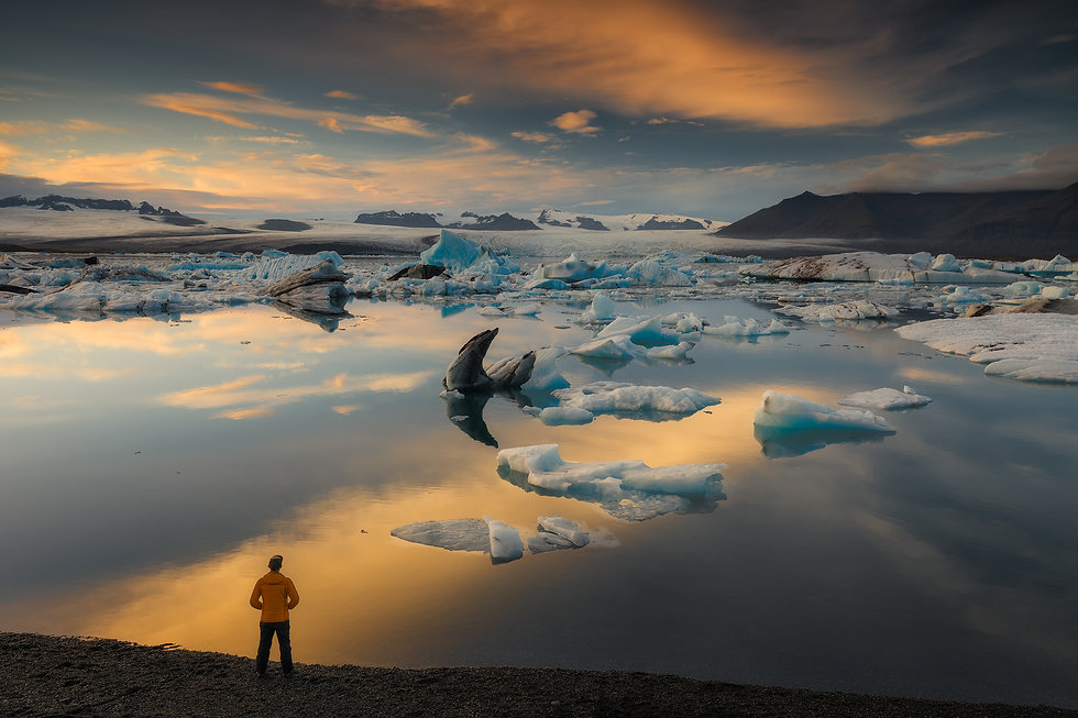 A person enjoing sunset views at Glacier lagoon in Iceland