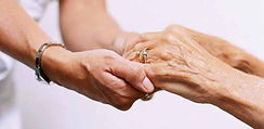 Photo of younger hands holding older hands