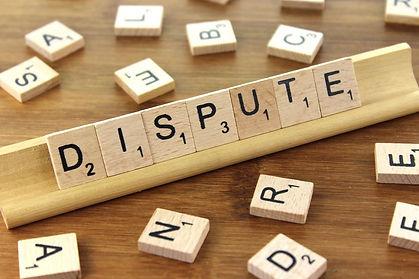 Image of Scrabble board saying Dispute