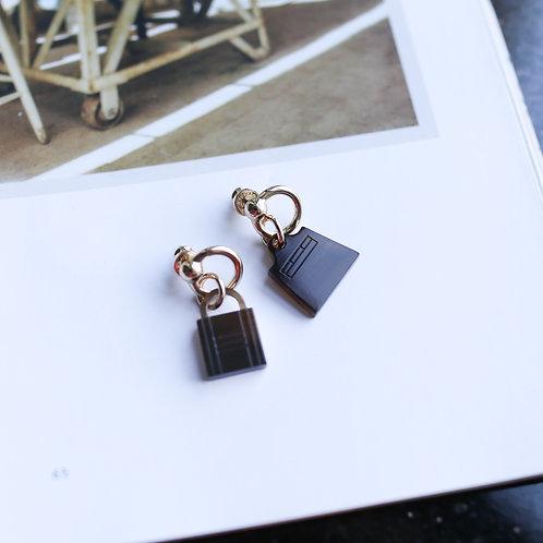 Hermes Amulettes Maroquinier earrings