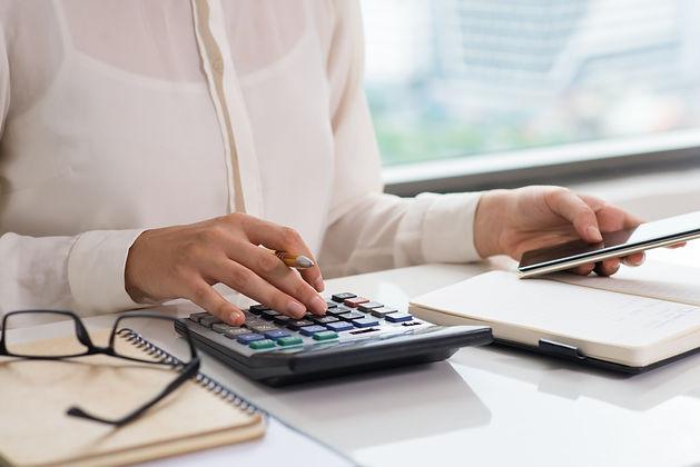 closeup-woman-using-calculator-smart-pho