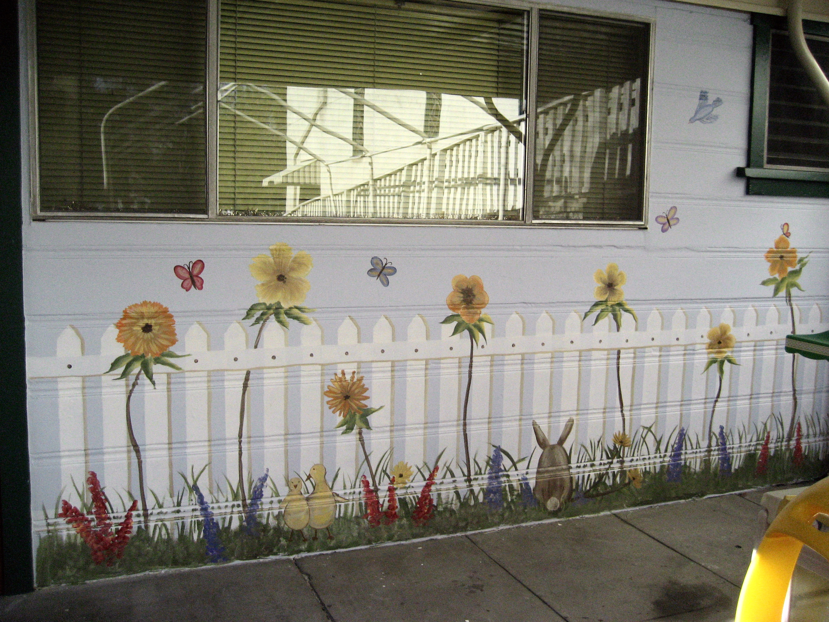 Outdoor floral garden & picket fence