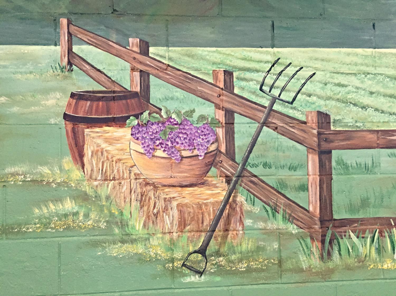 Closeup of grapes and barrel