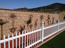 Outdoor topiary's painted on wall