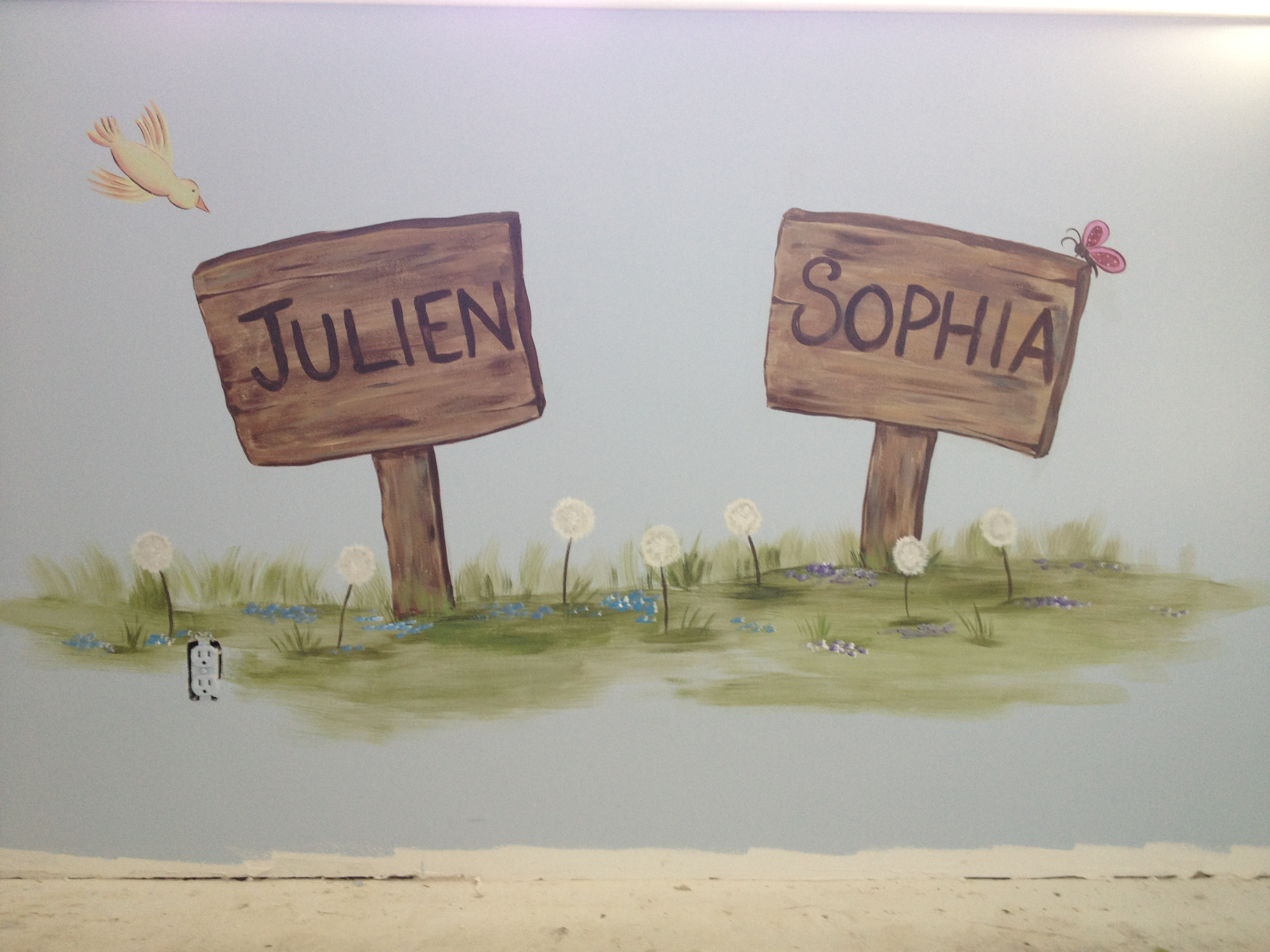 Children's names painted on a sign