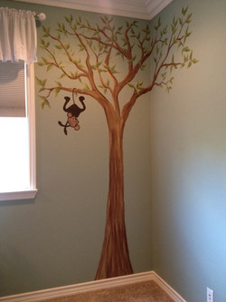 Hanging monkey in tree